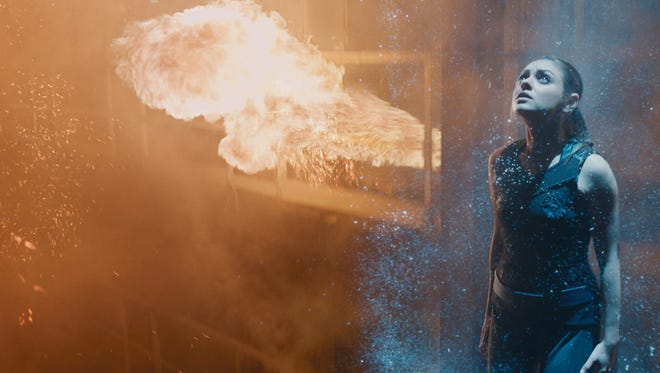 """Mila Kunis plays a Russian immigrant to the U.S. who learns she's actually Jovian royalty in """"Jupiter Ascending."""""""