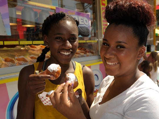 Ejaiya Burton, 12, left, and Tiyarra Burton, 12, both of Tulare get ready to eat deep fried Oreos Wednesday at the Tulare County Fair. There are plenty of different deep fried foods to try at the Tulare County Fair this year in Tulare. These deep fried foods range from Reese's Peanut Butter Cups wrapped with bacon to nutella to the traditional corn dog.