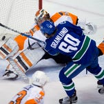 Gostisbehere has 3 assists, Flyers beat Canucks 3-2