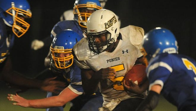 Chincoteague's Gardner Fosque (5) carries the ball against Northampton during thier game on Friday, Oct. 16, 2015. Chincoteague won the game 34-28. It was the Ponies' first win over Northampton in school history.