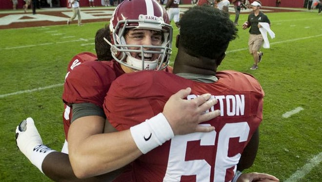 Alabama quarterback Jake Coker (14) celebrates with offensive lineman Lester Cotton (66) after the come from behind win over Tennessee at Bryant-Denny Stadium in Tuscaloosa, Ala. on Saturday October 24, 2015.