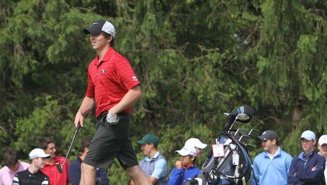 Rye's James McHugh walking at Fenway Golf Club during the boys Section 1 golf championship May 20, 2015. McHugh, who is now a junior, is the defending Section 1 champion.