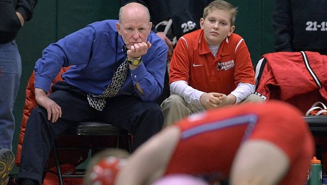 Honorary coach Nolan Redhead (top right) of Victor, right, sits with Penfield coach John Leone during last year's Takedown Cancer Duals at Rush-Henrietta High School.