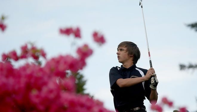 Bremerton's Bryce Kahle watches his shot during last year's Tim Higgins Memorial golf tournament at Kitsap Golf & Country Club.