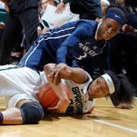 Michigan State's Branndais Agee, bottom and Penn State's Brianna Banks (3) dive for a loose ball Thursday, Feb. 11, 2016, in East Lansing, Mich. Penn State won 65-61.