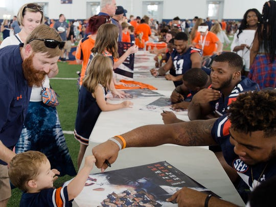 Auburn's Darrell Williams fist bumps a fan during Auburn
