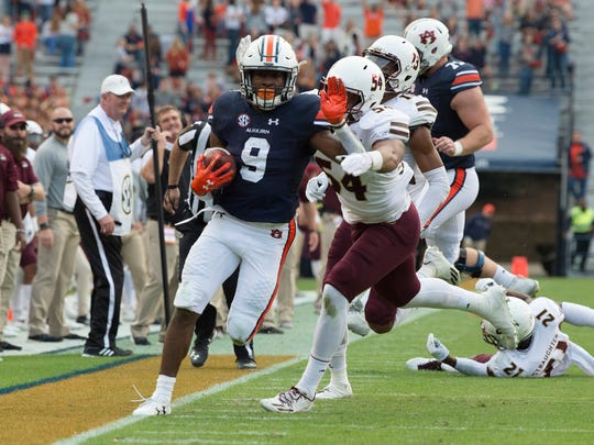 Louisiana Monroe linebacker Lee Marshall (54) pushes Auburn running back Kam Martin (9) out of bounds during the NCAA football game between Auburn and Louisiana Monroe on Saturday, Nov. 18, 2017, in Auburn, Ala.