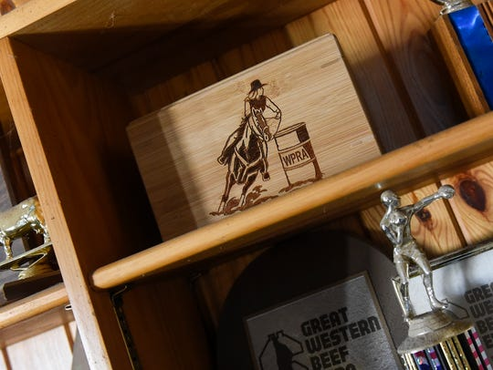 Mementos of Lacey Kuschel's rodeo career fill the bookshelves