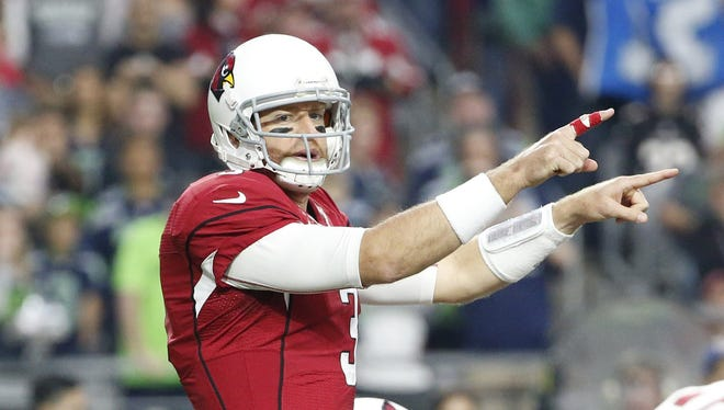 Arizona Cardinals QB Carson Palmer gives signals against the Seattle Seahawks in the first quarter during NFL action