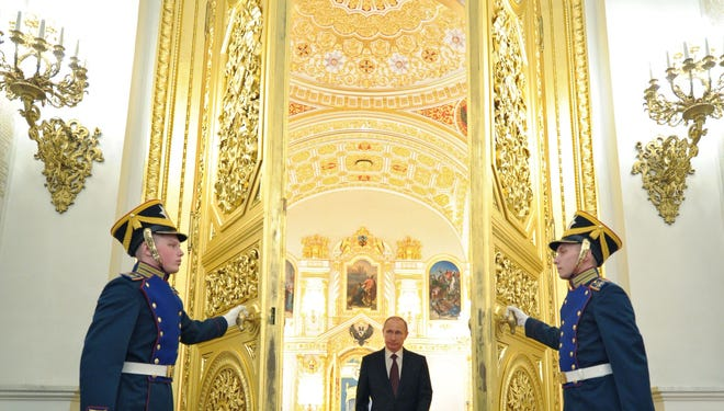 Russian President Vladimir Putin arrives for a meeting with the newly promoted top officers from various branches of the Russian armed forces and Interior Ministry at the Kremlin in Moscow on Friday.  Putin congratulated the armed forces for their role in the takeover by Moscow of Crimea from Ukraine, saying they had shown the new capacities of the Russian army.