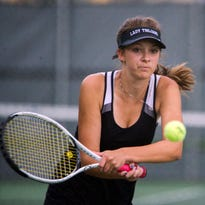Caroline Rachow of Wauwatosa West makes a run to the net in an attempt to return the ball against Wauwatosa East in a doubles match on Sept. 19. The game was rained out for the second time this season.