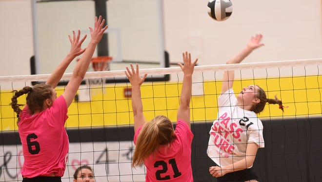 Granville's Erin Shomaker and Makinley Cramer look to block a Watkins hitter during their late-season match.