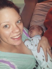 Brandi McGlathery holds her son Eli. Eli was born on