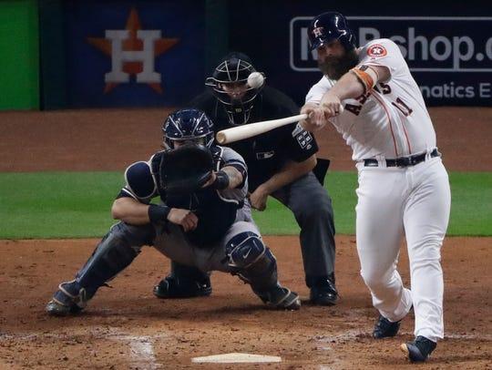 Houston Astros' Evan Gattis hits a home run during