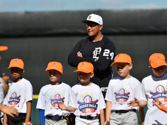Tigers first baseman Miguel Cabrera stands with young