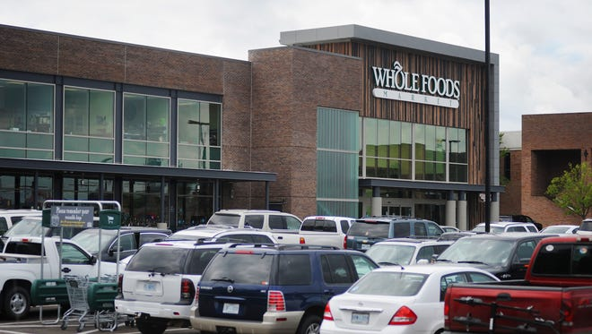 Cars fill the parking lot outside the new Whole Foods Market at Highland Village in Jackson.