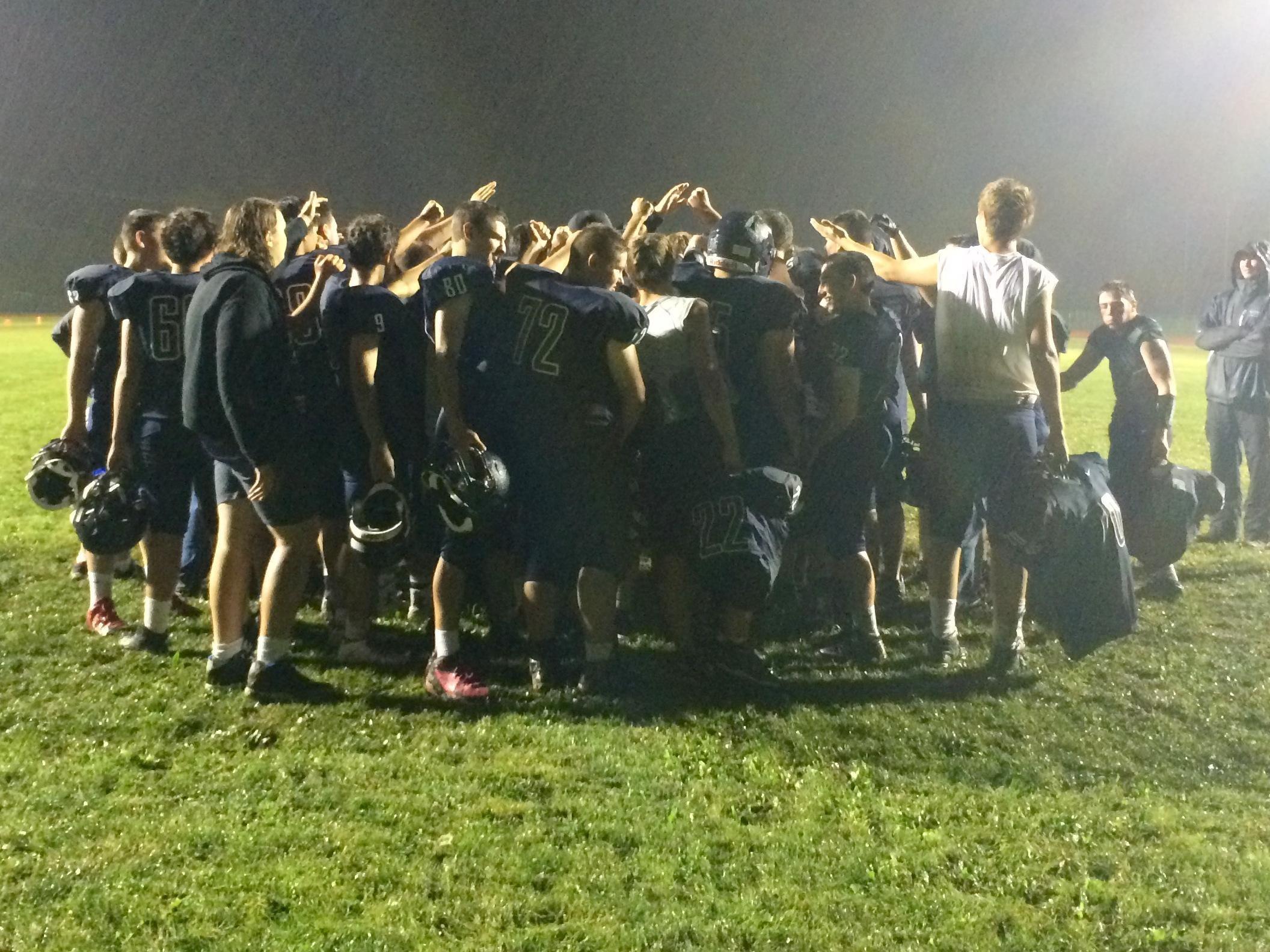 Watkins Glen/Odessa-Montour players celebrate their 54-32 victory over Notre Dame.