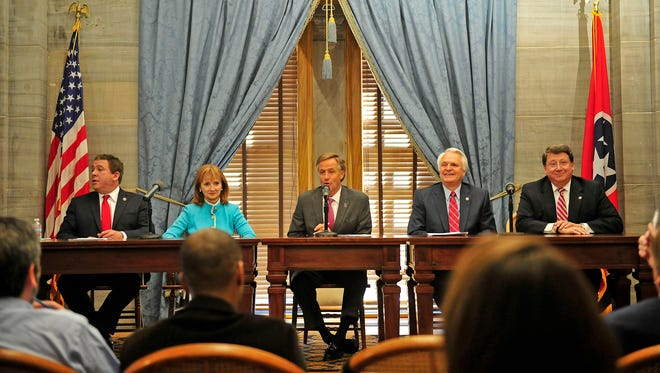 Gov. Bill Haslam, center, Lt. Gov. Ron Ramsey, second from right, House Speaker Beth Harwell, second from left, State House Majority Leader Gerald McCormick, left, and State Senate Majority Leader Mark Norris attend at a news conference at State Capitol in Nashville, Tenn., Thursday, April 23, 2015.