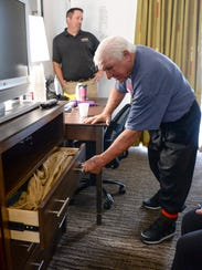 Jessie Alexander, right, looks at a drawer of donated