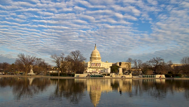 The U.S. Capitol is seen in front of the reflecting pool days before the Inauguration of President-elect Donald Trump, Sunday, Jan. 15, 2017. ( AP Photo/Jose Luis Magana)
