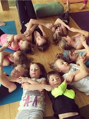 Children in a yoga class take time for rest at Community Soul Yoga in Wausau.