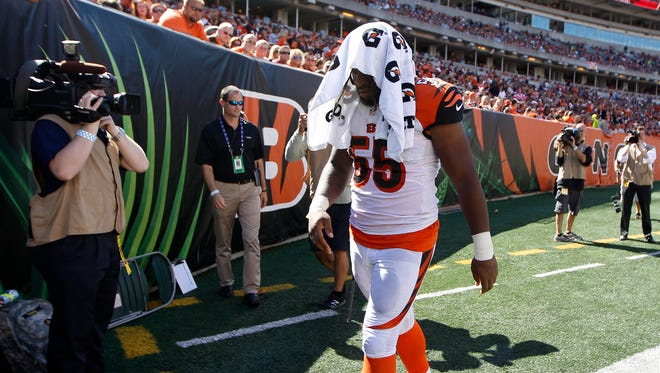 Cincinnati Bengals outside linebacker Vontaze Burfict (55) walks off the field with a head injury against the Atlanta Falcons at Paul Brown Stadium. The Enquirer/Jeff Swinger