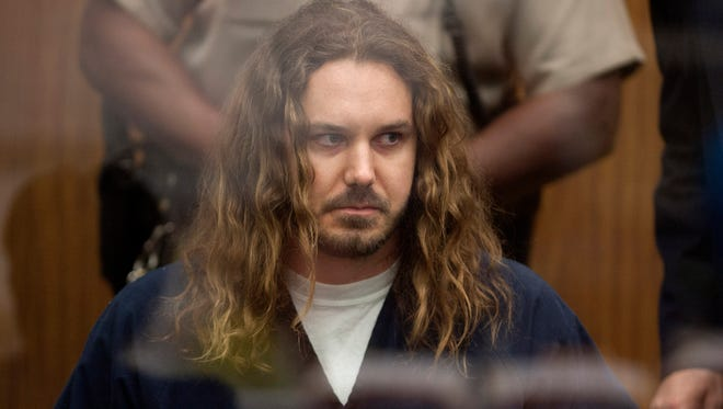 Tim Lambesis, 32, frontman for the Christian-inspired heavy metal group As I Lay Dying, appears in Vista Superior Court in Vista, Calif. in May 2013.