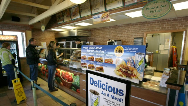 Customers wait in line Friday, March 9, 2007, at a Subway restaurant in Portland, Maine.