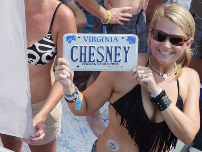 Fans gear up for Chesney's free beachplay for 40,000 on the Florida/Alabama line, behind the historic Flora-Bama on August 16, 2014 in Orange Beach, Alabama.