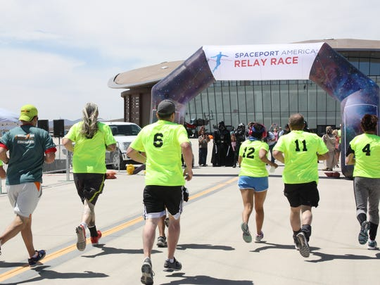 "Team ""BLM Friends"" crosses the finshline together at the end of the inaugural Spaceport America Relay Race, which went from El Paso, through the Mesilla Valley and into Spaceport America in Sierra County on Sunday, April 9, 2017."