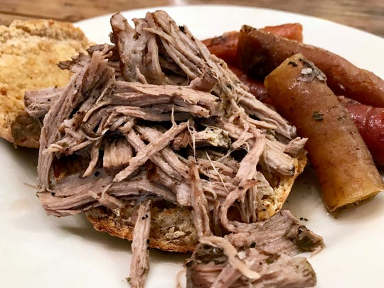Carrots infuse the pork shoulder roast with additional