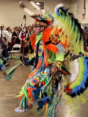 A dancer participates in the grand entry of the Red River Intertribal Club's Benefit Powwow at the National Guard Armory in 2016.