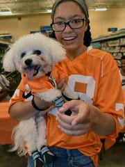 Reanna Younger holds Kilo, a Bichon Frise, the first place winner of the pet Vol Walk on Saturday July 24, 2018.  A dozen pet adoption groups were on hand at the PetSmart store on Morrell Road in Knoxville offering a 10 percent discount on pet adoptions.