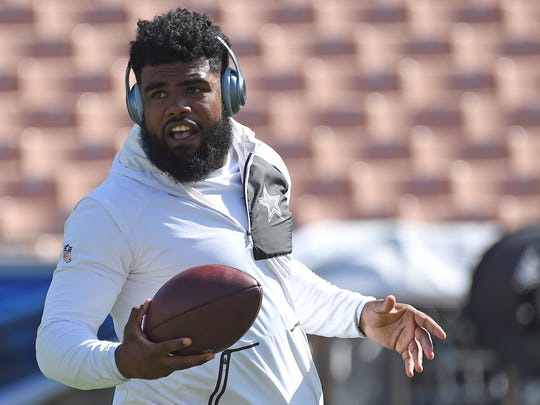 Dallas Cowboys running back Ezekiel Elliott (21)  warms up before the game against the Los Angeles Rams at the Los Angeles Memorial Coliseum.