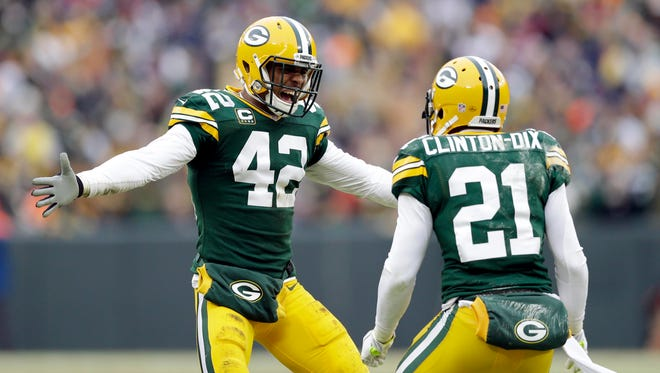 Green Bay Packers strong safety Morgan Burnett (42) and free safety Ha Ha Clinton-Dix (21) react after a play call was overturned in the 2014 NFC Divisional playoff football game against the Dallas Cowboys at Lambeau Field.