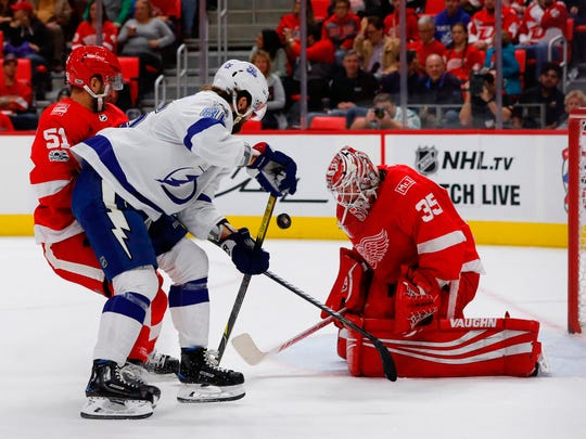 Red Wings goalie Jimmy Howard (35) makes a save against Lightning right wing Nikita Kucherov (86) in the first period on Monday, Oct. 16, 2017, at Little Caesars Arena.