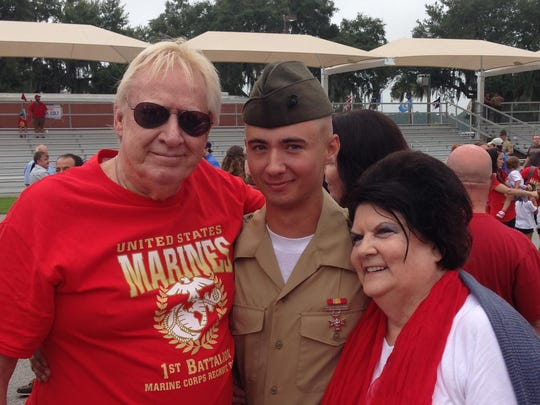 Alec Hemphill stands with his Marco grandparents, Ken and Carol Knauf.