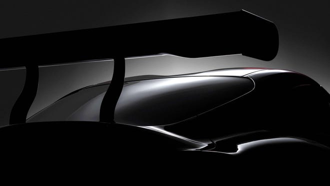 "Toyota teased its coming Supra with this photo of ""a modern racing concept (that) signals Toyota's commitment to bring back to the market its most iconic sports car. Get the full scoop on March 6th at 3:45 a.m. (EST)."" The concept echoes the FT-1 concept shown in Detroit in 2014 with its dual-bubble roof, duck tail trunk, and high wing."