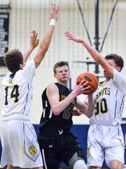 Adam Freese (center) drives through two Eastern York defenders during a game in 2016-17. Freese was the Rams' top scorer from last year, averaging 18.9 points per game.
