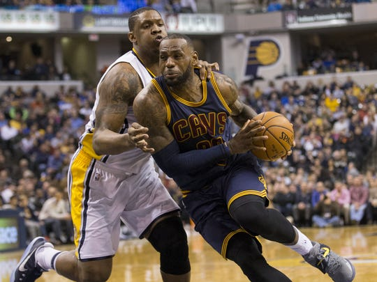 LeBron James blows past Kevin Seraphin of Indiana, during Cleveland Cavaliers at Indiana Pacers, Bankers Life Fieldhouse, Indianapolis, Wednesday, February 8, 2017. Indiana lost 117-132 to the reigning NBA Champions.