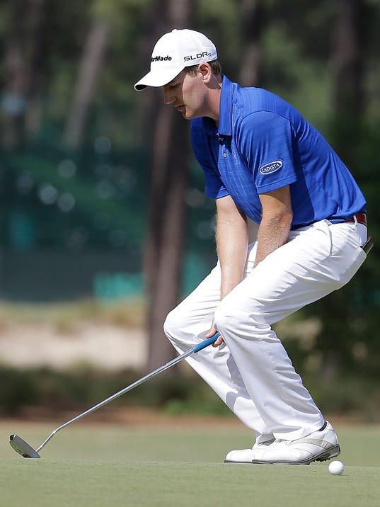 Brendon Todd reacts after missing a putt on the sixth hole during the third round of the U.S. Open golf tournament in Pinehurst, N.C., Saturday, June 14, 2014. (AP Photo/Eric Gay)