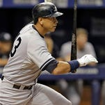 New York Yankees' Alex Rodriguez flips his bat after hitting an RBI double off Tampa Bay Rays relief pitcher Brad Boxberger during the ninth inning of a baseball game Monday, Sept. 14, 2015, in St. Petersburg, Fla.  Yankees' Brett Gardner scored on the hit.  The Yankees defeated the Rays 4-1. (AP Photo/Chris O'Meara)