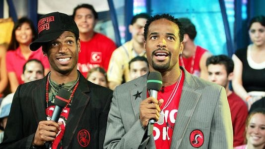 (L-R) Actors Marlon Wayans and Shawn Wayans appear on stage during MTV's Total Request Live at the MTV Times Square Studios June 22, 2004 in New York City.