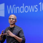 FILE - In this Jan. 21, 2015 file photo, Microsoft CEO Satya Nadella speaks at an event demonstrating the new features of Windows 10 at the company's headquarters in Redmond, Wash. Microsoft reports quarterly financial results on Monday, Jan. 26, 2015. (AP Photo/Elaine Thompson, File) ORG XMIT: NYBZ301