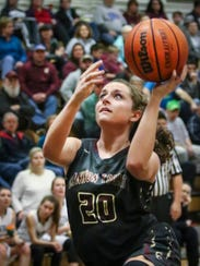 Cannon County's Samantha Gaither goes in for a layup