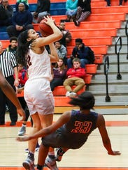 Riverdale's Brinae Alexander eyes the basket as Smyrna's