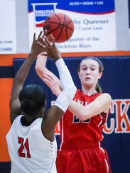 Oakland's Maggie Knowles passes over Stewarts Creek's