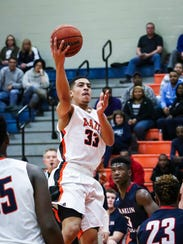 Blackman's Trent Gibson goes in for a layup during