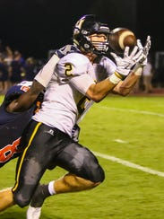 Hendersonville's Gabe Dalton eyes a pass into his hands.