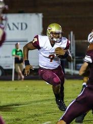 Riverdale quarterback Christian Souffront finds running